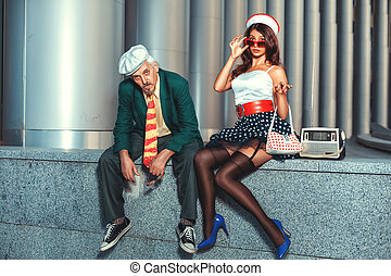 Old man with a young woman - Old man with a young woman in...