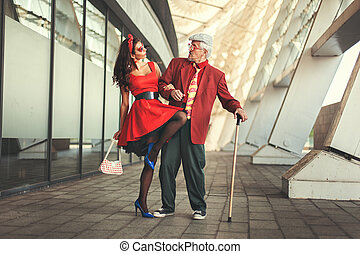 Old man dancing with a young girl. - Old man dancing with a...