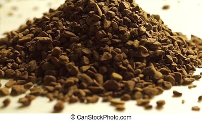 Rotating pile of instant coffee, macro video clip