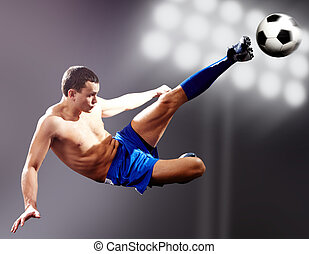 Professional kick - Professional footballer kicking soccer...