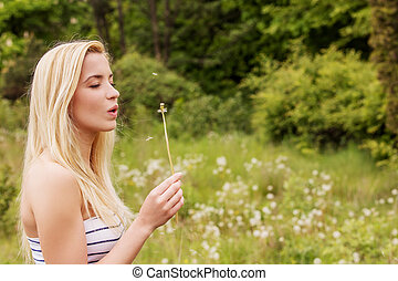 Young woman posing with flowers Outdoor shot - Young blonde...