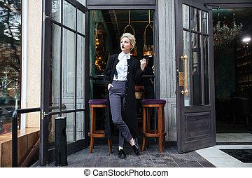 Stylish fashion blogger posing at cafe - Stylish young...