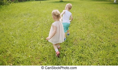 Kids running across green grass