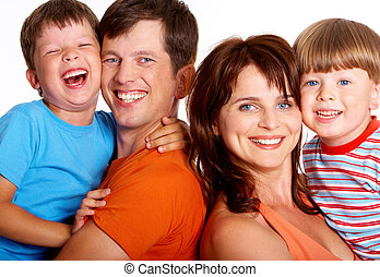 Happiness - Portrait of cheerful family members having a...