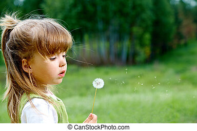 Fragility - Profile of cute girl with white dandelion...
