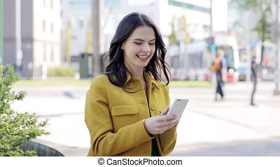 happy young woman or teenage girl with smartphone -...