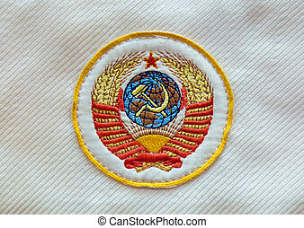 Fabric soviet USSR emblem with hammer and sickle on uniform.