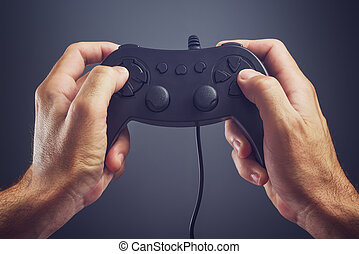 Man using game pad controller to play video games - Man...