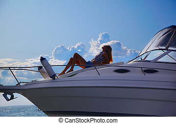 blonde on yacht - young beautiful blonde outdoors, posing on...