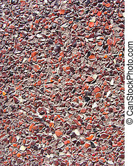 concrete with tiny black white red stone pebbles wall