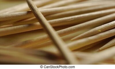 Pile of wooden toothpicks macro dolly shot clip