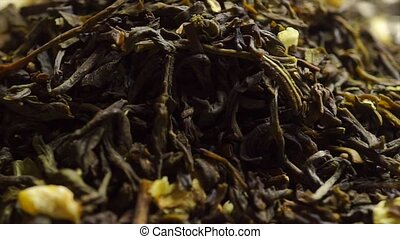 Rotating pile of jasmine green tea, macro video clip