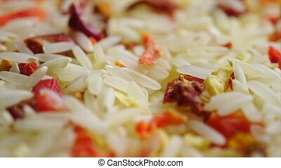 Heap of uncooked rice and dried vegetables. Macro video clip