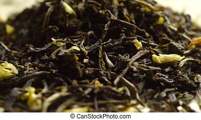 Rotating pile of jasmine green tea