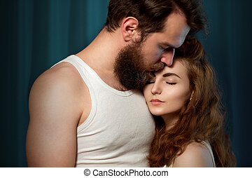 Portrait of a bearded, brutal guy and beautiful girl -...