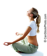 Renewing energy - Attractive woman meditating in pose of...