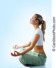 Peace - Profile of woman meditating in pose of lotus in...