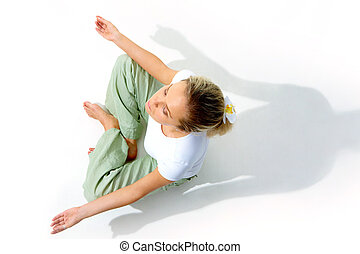 Yoga practice - Above view of young woman meditating in pose...