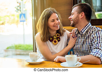 Two people in cafe
