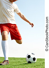 During match - Portrait of a soccer player with ball on...