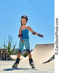 Girl riding on roller skates . - Girl wearing roller skates...
