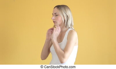 Young woman having a sore throat