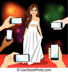 Beautiful famous woman posing on red carpet for people with smartphones