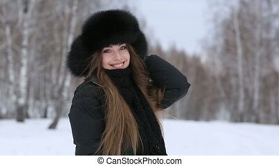 Beautiful smiling girl outdoors in winter - Video of...