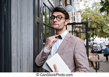 Funny man wearing eyeglasses and bow at the cafe - Funny...
