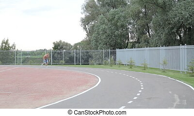 Man jogging in on dirt track
