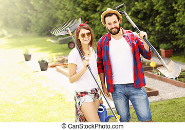Young couple working in the garden