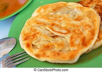 Traditional Indian delicacy - Crispy Indian roti prata...