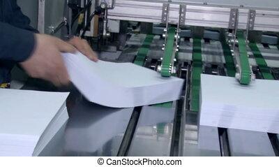 Hands zaberat pack sliced paper transport belt - Work shop...