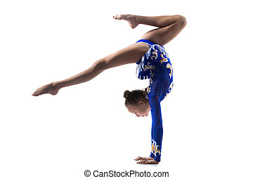Teenage acrobat girl doing handstand - Beautiful gymnast...