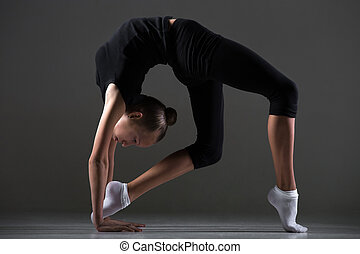 Girl doing backbend exercise - Beautiful cool young fit...