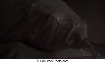 Airsoft rounds hitting sandbag in the dark Close up video...
