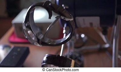 Watch repair shop. Automatic winding device clip