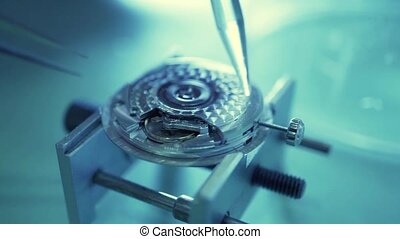 Watch movement being repaired in a repair shop. Macro video...