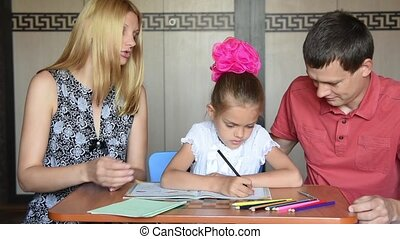 Parents show a child that she made mistakes doing homework