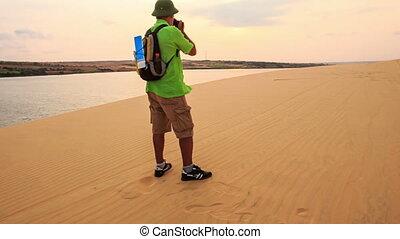 Closeup Tourist Photos Landscape in White Sand Dunes -...