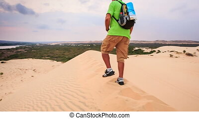 Old Man Sits down on Crest Cries with Joy in White Sand Dunes