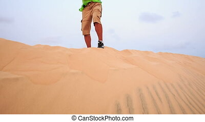 Old Man Makes Selfie on Crest against White Sand Dune...