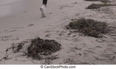 Young fit sports woman running on the beach Super slow...