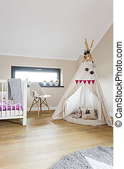 Child attic bedroom with a wigwam tent