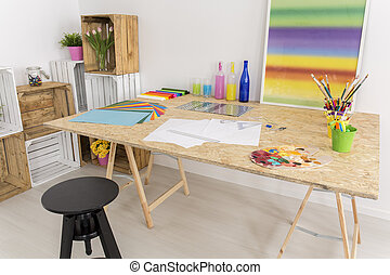 White room for arts and crafts - Big wooden table in the...
