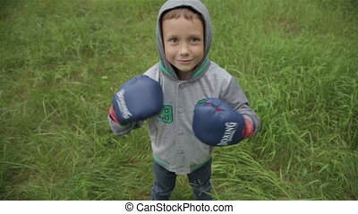 Boy in boxing gloves - Funny boy in boxing gloves