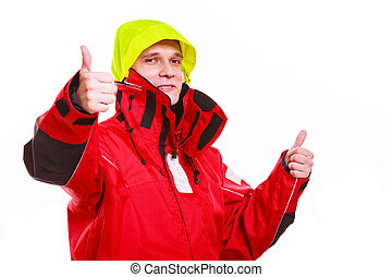 Hooded man in waterproof jacket Young male man in protective...