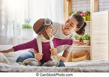Mother and child girl playing - Happy family is preparing...