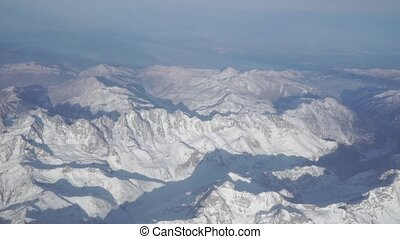 The Caucasus peaks on sunny day Aerial view - The Caucasus...