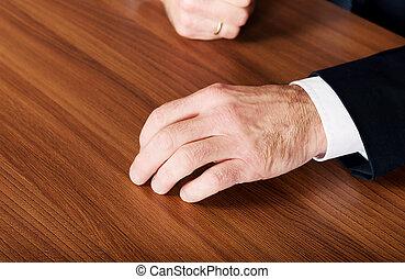 Businessman's hands put on the desk - Mature businessman's...